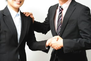 Handshake of businessman wearing a suit