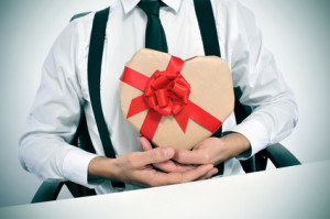 businessman with a heart-shaped gift
